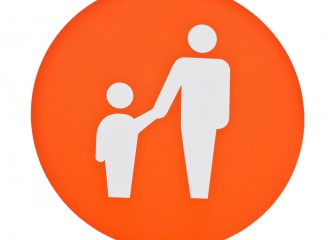 orange parent and child parking sign on post pole (isolated on white background)
